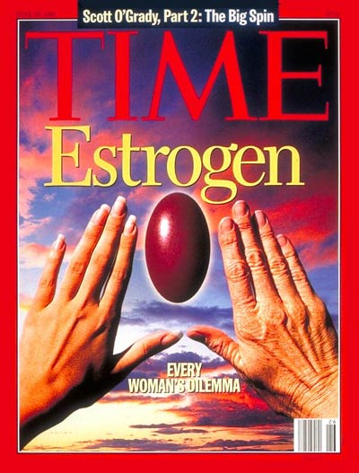 Every Woman's Dilemma.  Youthful left hand and aging right hand with estrogen pill framed between them against sunset sky