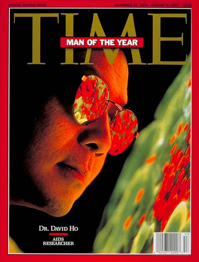 AIDS researcher Dr. David Ho, TIME's Man  the Year, examines enlarged image of a T cell infected with the AIDS virus; electron micrograph from NIBSC/SPL-Photo Researchers.