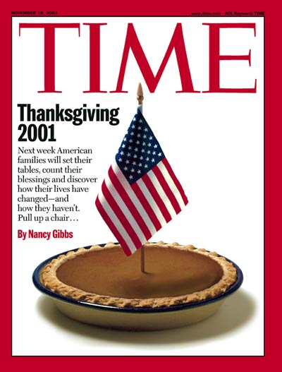 A pumpkin pie with an American flag in represents the Thanksgiving holiday. No Photo Credit given.