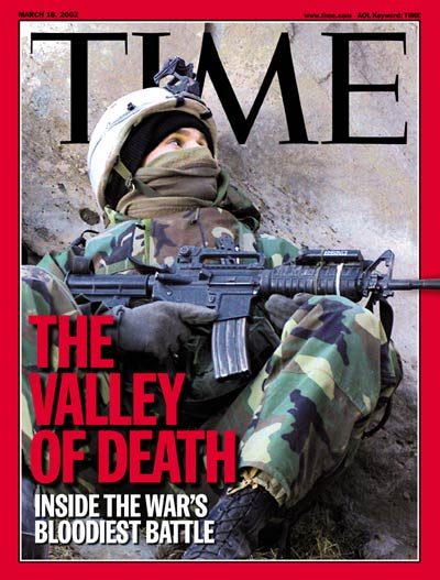 U.S. soldier taking cover in Afghanistan. Ongoing War on Terror. From U.S. Army pool.