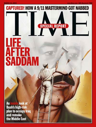 Man whitewashing picture of Iraq leader Saddam Hussein.