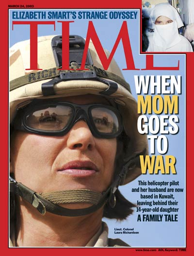 U.S. Army helicopter pilot Laura Richardson. Women serving in combat. U.S. Army helicopter pilot Laura Richardson on duty in Kuwait. Mothers going to war. From Corbis.