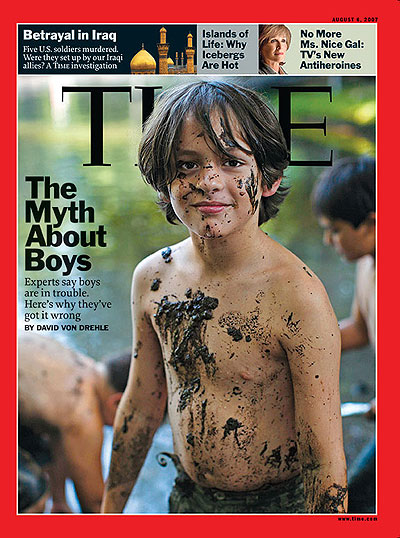 A young shirtless boy with mud all over him. David Burnett/Contact