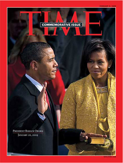President Barack Obama swearing in on the Bible Michelle Obama holds