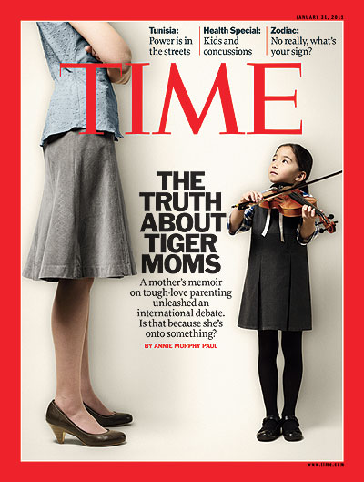 A woman oversees her daughter playing the violin