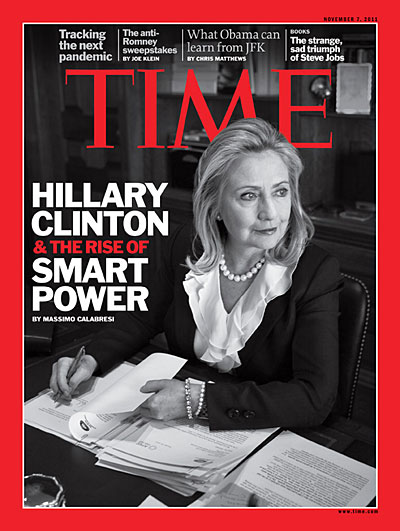 A portrait of Hillary Clinton at her desk