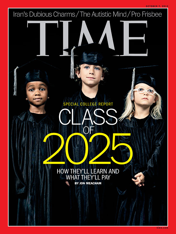 Three children standing in graduation outfits againt a black backdrop