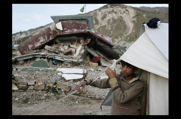 An earthquake survivor near his tent at the Mehra Tanolia camp in Muzaffarabad, Kashmir