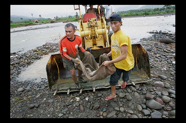 in humility consider others better than yourself philippine  time photo essay buried in mud a philippine village is wiped out by a
