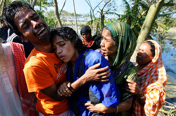 A Bangladeshi couple mourns the death of their son
