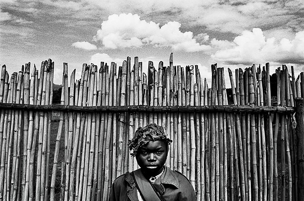 A boy soldier waits at the Kpandroma transit center. The various warring factions of the country have used children as fighters, porters, cooks, spies and sex slaves.