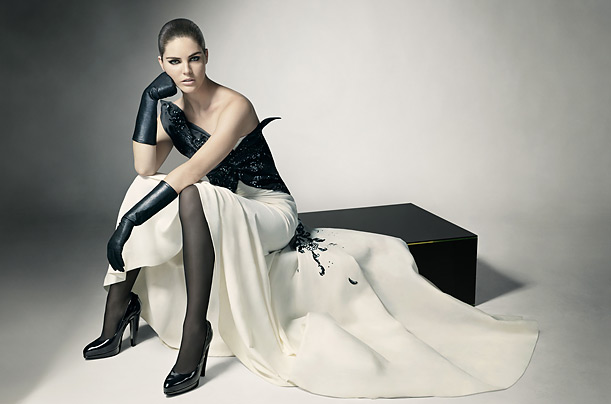 Model Hilary Rhoda wears a Dior by John Galliano silk gazar gown, Lanvin patent-leather pumps and LaCrasia leather gloves.