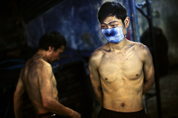 A worker takes a break after working through the night. The blude dust from the jeans is heavy irritant to the lungs.