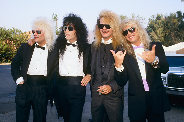Rikki Rocket, Bobby Dall, C.C. DeVille and Bret Michaels pose on the red carpet at the MTV Music Awards.