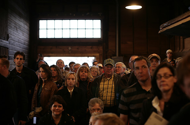 Iowans listen to Obama speak during a town hall meeting in Chariton.