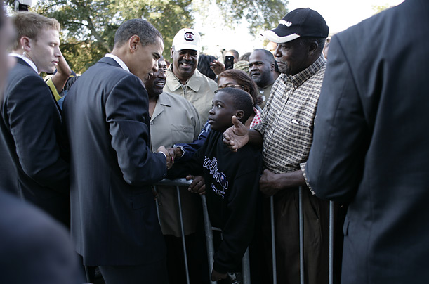 Obama greets a young supporter after a rally outside the courthouse in Manning, South Carolina.