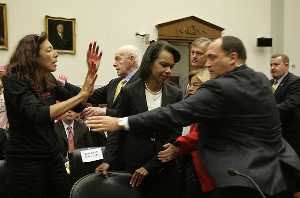 Pictures of the Year Best Photographs Pictures Time MagazineA protester shows red-painted hands to Secretary of State Condoleezza Rice before the Secretary testifies