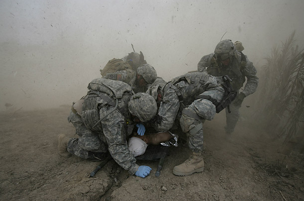 Pictures of the Year Best Photographs Pictures Time Magazine U.S. soldiers shield a wounded comrade from debris kicked up by a rescue helicopter in Qubah, Iraq.