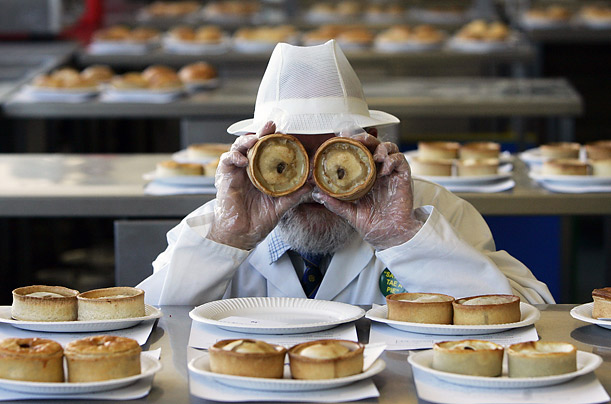 Pictures of the Year Best Photographs Pictures Time Magazine World Pie Championship judge John Young poses with two scotch pies at a competition in Dunfermline, Scotland.