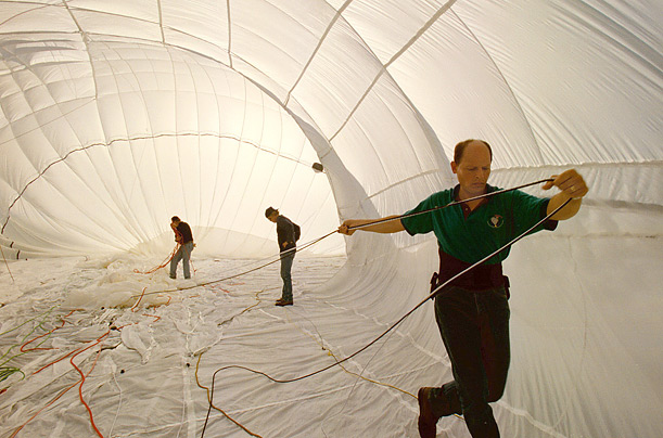 The crew of the Solo Spirit, a predecessor to the Spirit of Freedom, makes preparations inside the balloon's canopy.