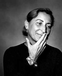Miuccia Prada - 2018 Light Brown hair & Bun hair style. Current length:  medium long hair (neck length)