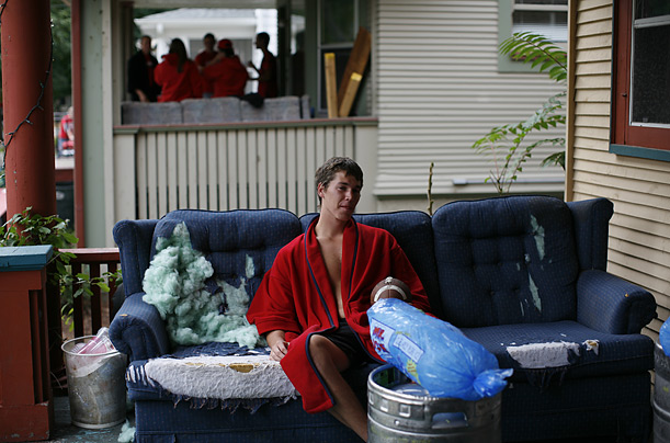 University of Wisconsin student Eric Paquette relaxes on a sofa in front of a house two blocks from Camp Randall Stadium in Madison, prior to a Badgers game against Michigan State.