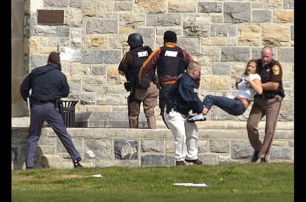 A person is carried out of Norris Hall at Virginia Tech after the shooting.