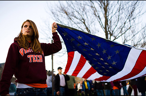 Danya Hakeem, 19, holds a flag at a vigil on the Virginia Tech campus