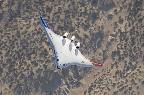 The X-48B soars over Edwards Air Force Base, where it was tested in August. During the test, the plane was piloted remotely by engineers on the ground.