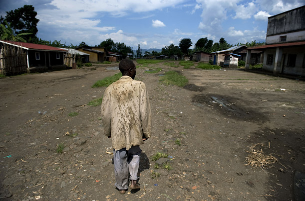 A man walks through the empty market of the Kabaya village, about 50 kilometers (30 miles) north of the provincial capital of Goma, Congo, October 18, 2008. Residents fled last October 8, when the Forces loyal to renegade
