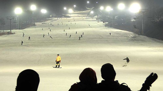 Skiers enjoy night ski resort which is part of Jisan Forest Resort in Duckpyeong, South Korea