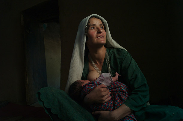 Siamoy feeds her one-month old baby in Badakshan, where a harsh landscape and lack of infrastructure have given rise to an astonishingly high rate of deaths during childbirth.
