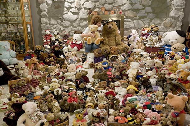 Janice Hanson, 57, displays her collection of teddy bears in the living room of her home in Chili, New York.