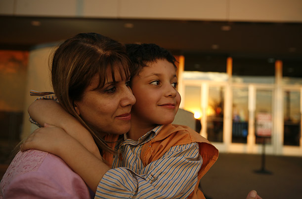 Faeza Jaber and her son Khatab pause outside a mall in Phoenix, Arizona, where they relocated after the killing of her husband Omar, who was shot by an unknown assailant in March 2004.