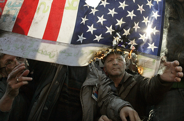 Serbian protesters set fire to an American flag. The crowd directed much of its anger towards the United States, for its support of Kosovo's claim to independence.