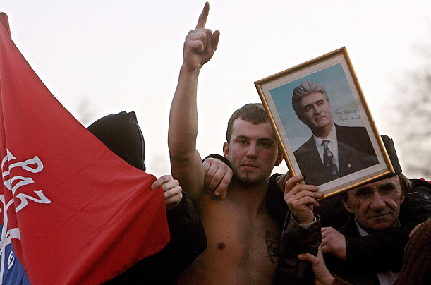 Many protesters carried images of Radovan Karadzic, A Bosnian Serb leader who has been indicted for war crimes by the International Criminal Tribunal in The Hague. He is presently a fugitive.