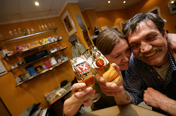 Zur Firma owner Wolfgang Schmelz (r) and Erika Zachhuber (l) enjoy a beer at the bar. Though many older Germans feel