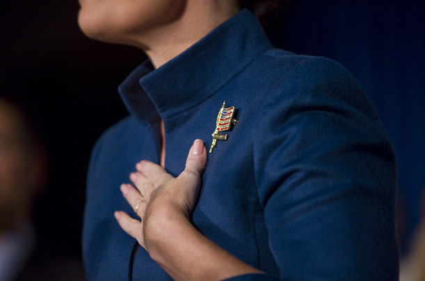 Palin's flag pin reads,