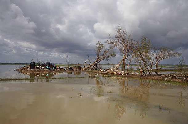 Flooded fields, shattered homes