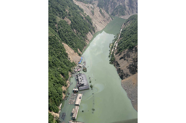 A power station behind Kuzhu dam in Beichuan County lies underwater.