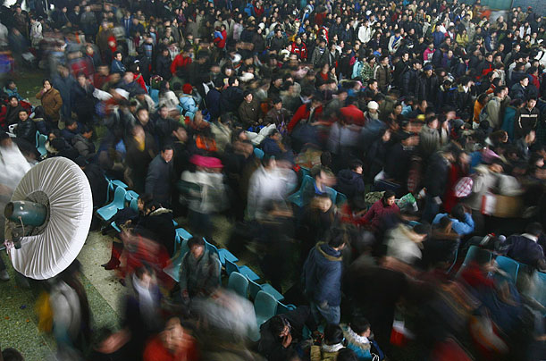In Hefei, Anhui province, passengers line up to buy rail tickets.