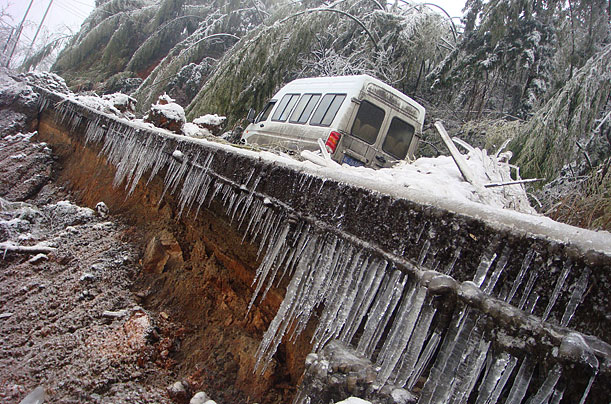 A minibus is stranded on an ice-covered road in Chenzhou, Hunan province