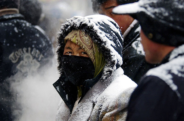 A Chinese woman bundles up against the cold in Lanzhou, in northwest Gansu province
