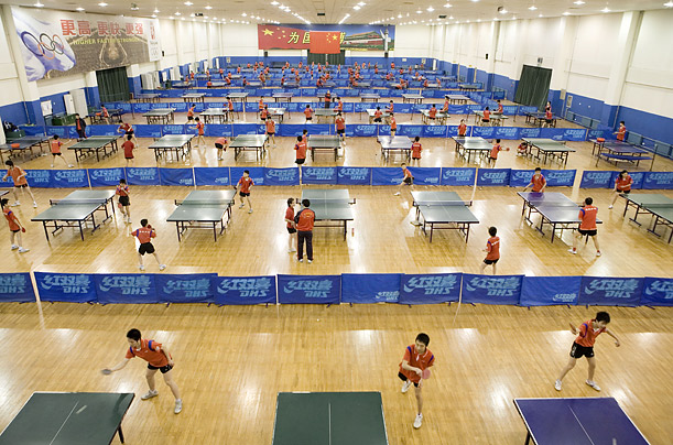 China is the only country in the world with academies dedicated to what most countries consider a recreation room pastime. At the Luneng Table Tennis School in Shandong province, 230 boarding students crowd a gymnasium set up with 80 ping-pong tables.