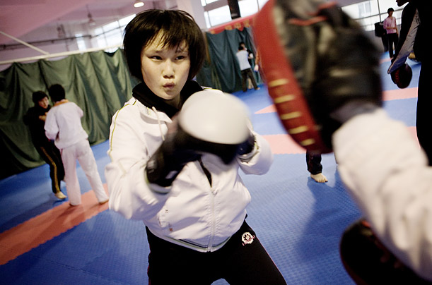 A female boxer participates in a sparring session. Many athletes in lesser-known sports had never heard of the sport before they were recruited.