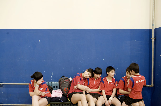 Students take a break after a long table tennis training session.