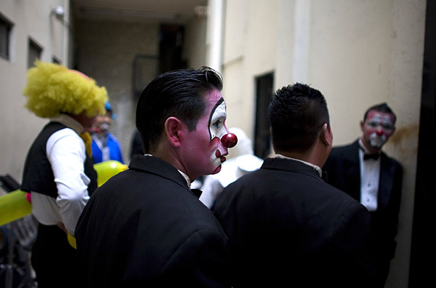 The event includes performances judged by clowns in greasepaint and big red noses.