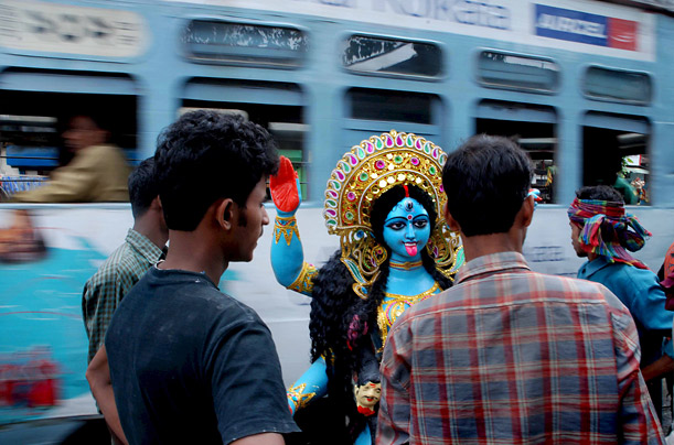 Residents of Calcutta carry a clay idol on the eve of the holiday, which this year lands on October 28