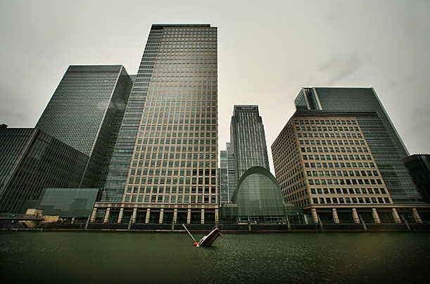 A sculpture of a sinking yacht sits under the sky scrapers of Canary Wharf on September 30, 2008 in London, England. World financial markets suffer further losses as the banking crisis continues.