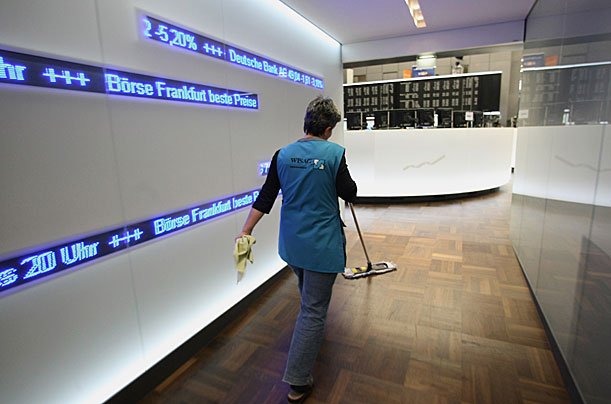 SEPTEMBER 30:  A cleaning woman wipes the floor of Frankfurt stock exchange during a trading session on September 30, 2008 in Frankfurt am Main, Germany. Due to the weakness of the U.S. economy the German stock market remains volatile.